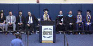 Michael at podium in cap and gown