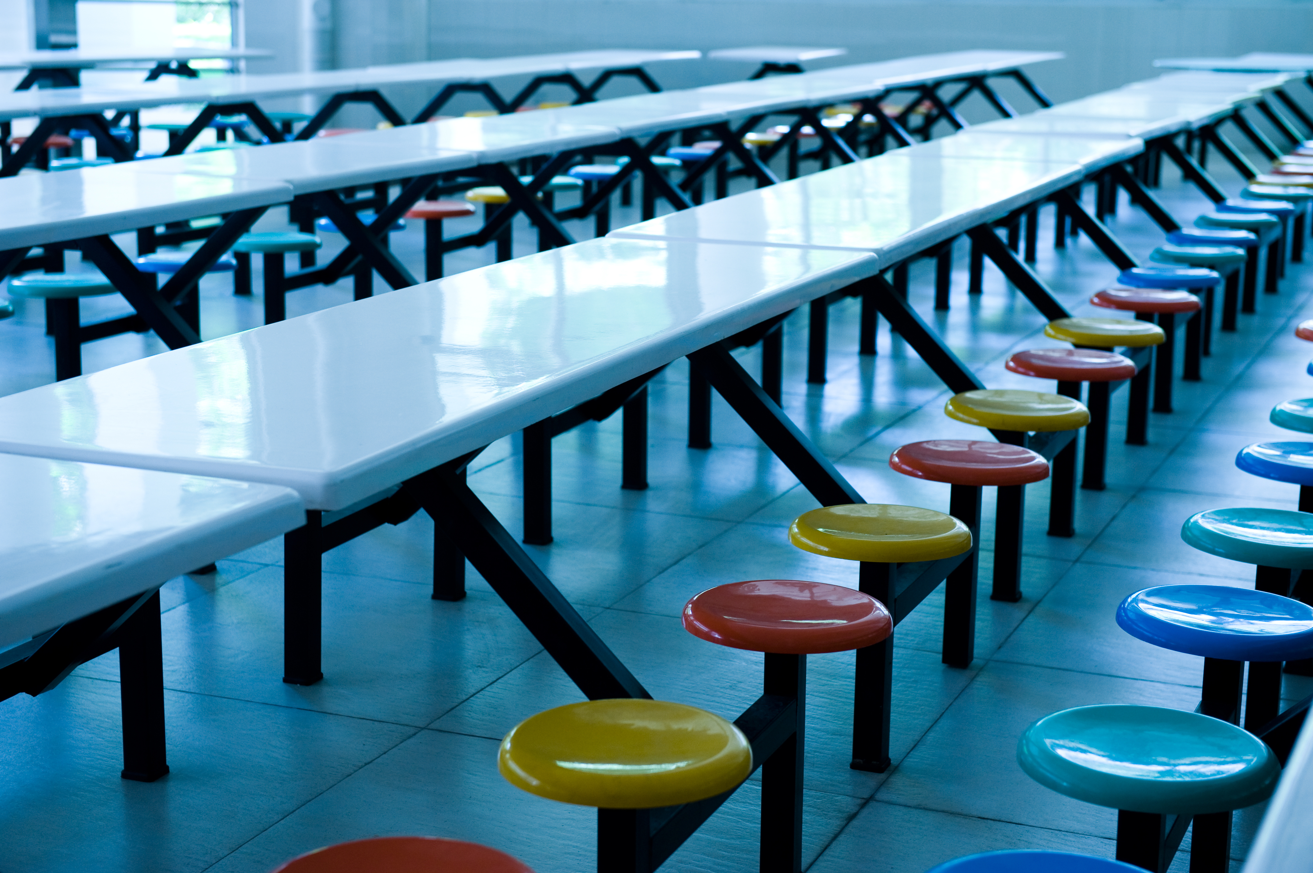 empty seats and tables in a cafeteria